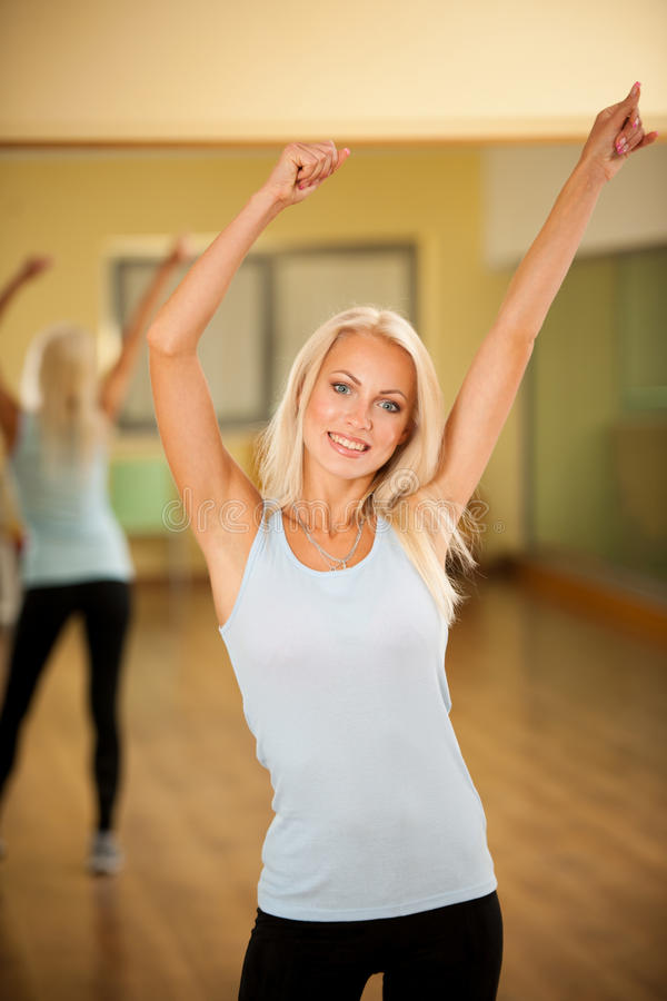 Fitness dance class aerobics. Women dancing happy energetic in g stock photos