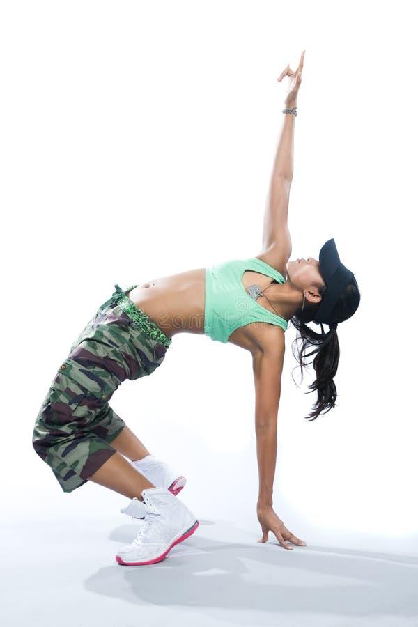 Fitness dancer striking a backward pose. Very healthy fitness dancer striking a backward pose stock image