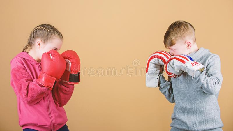 Fitness diet. energy health. punching knockout. Childhood. Sport success. Friendship fight. workout of small girl and. Boy boxer in sportswear. Happy children stock photos