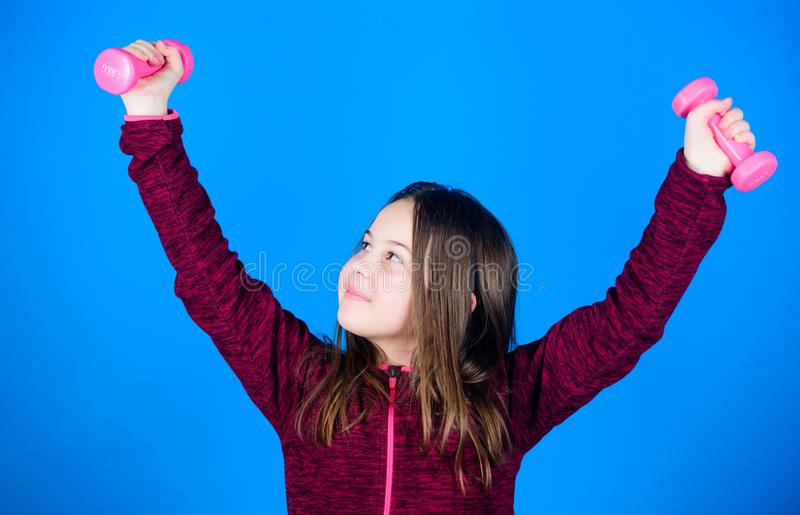 Fitness diet for energy health. Sport success. gym workout of small girl hold dumbbell. Happy child in gym with barbell. Weight lifting for muscules. Childhood stock photos