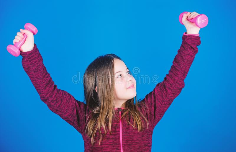 Fitness diet for energy health. Sport success. gym workout of small girl hold dumbbell. Happy child in gym with barbell. Weight lifting for muscules. Childhood stock image