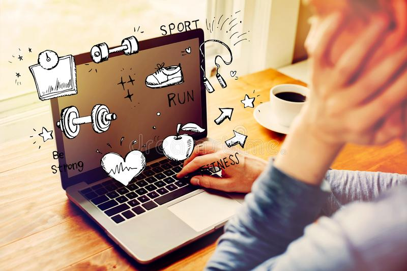 Fitness and diet with man using a laptop stock photography