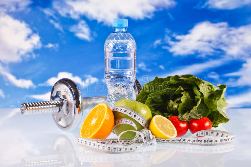 Fitness dumbbells and fruits stock photo