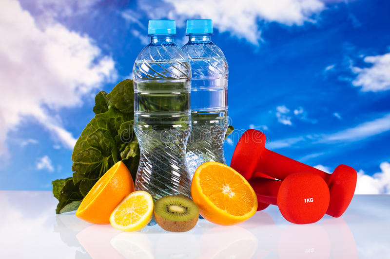 Fitness dumbbells and fruits royalty free stock photography