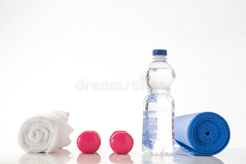 Fitness dumbbells and water stock photography