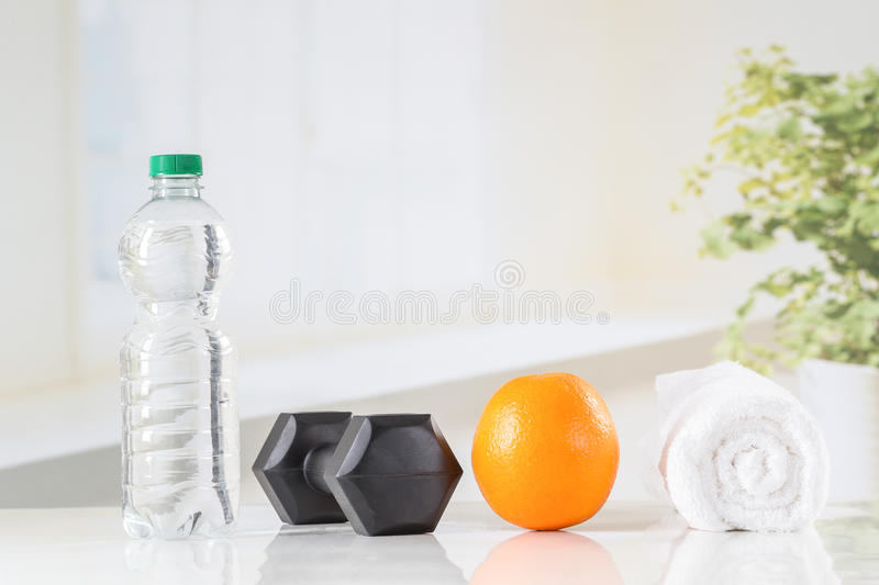 Fitness dumbbells and water royalty free stock image