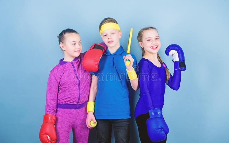 Fitness energy health. punching knockout. Team sport success. workout of small girls boxer and boy in sportswear. Happy stock image