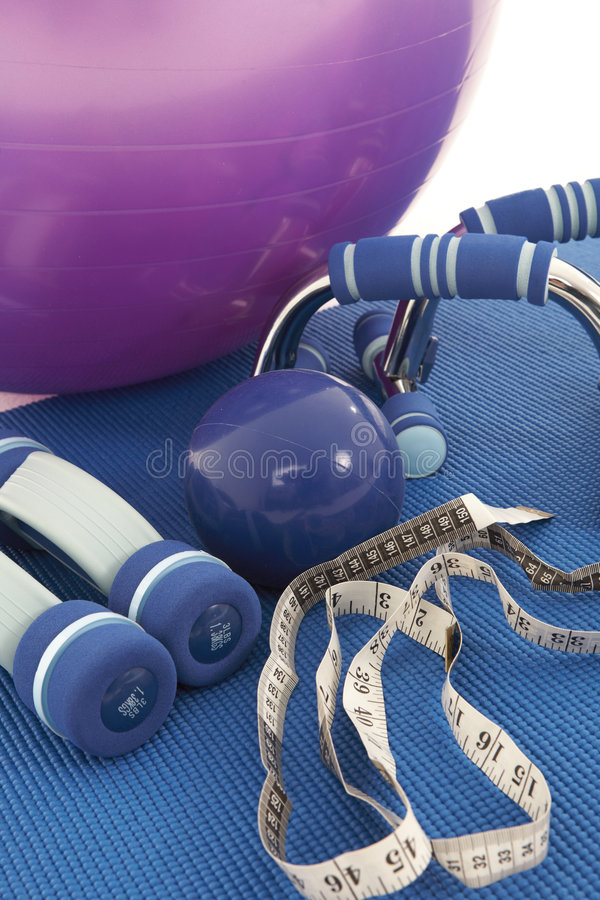 Fitness Equipment. Collection of fitness equipment on a soft yoga matt royalty free stock photos