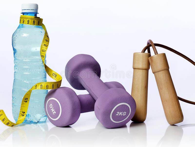 Fitness equipment on blue royalty free stock photos