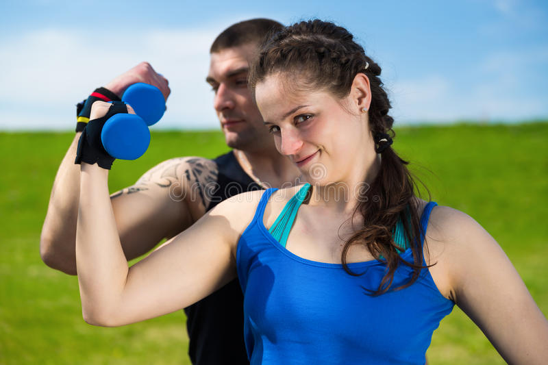 Fitness exercise with dumbbells . stock images