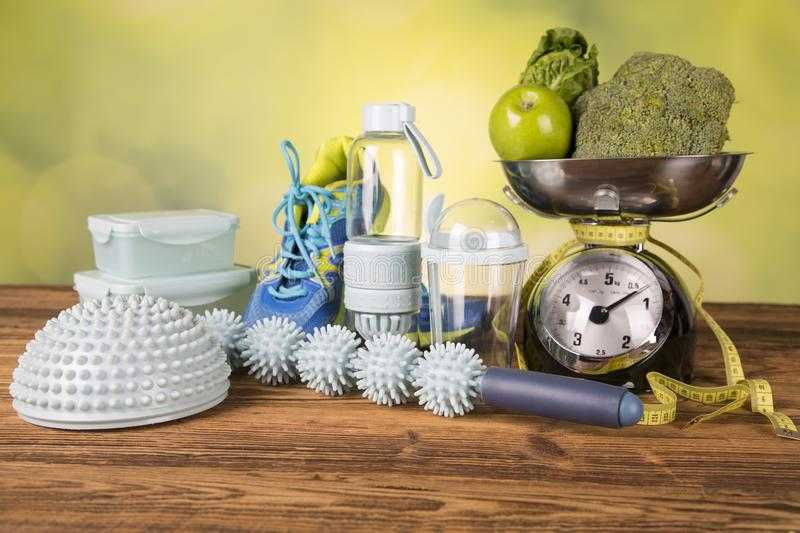 Devices for body massage. Containers for healthy food, Devices for body massage, Sport shoes for exercise stock photography