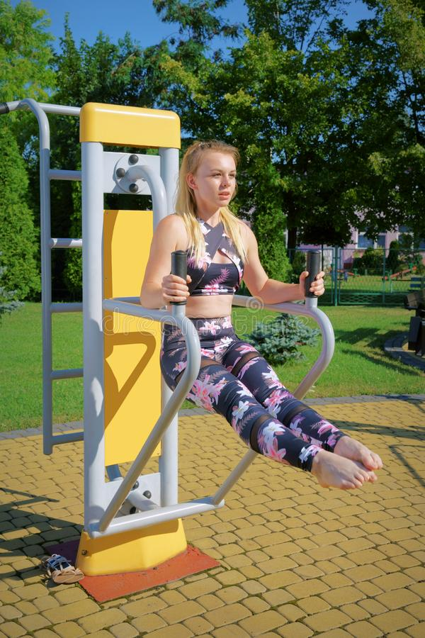 Fitness, exercising girl at the gym, outdoors royalty free stock image