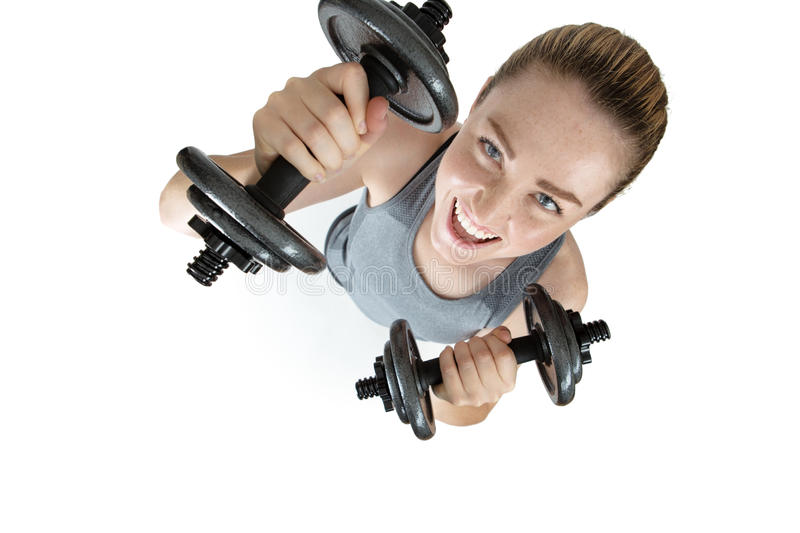 Fitness female exercising with dumbells stock photo