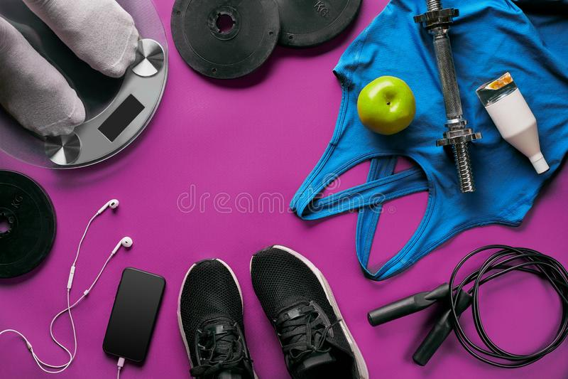 Fitness female outfit background top view. Set of sport clothing and equipment for women, active lifestyle royalty free stock images