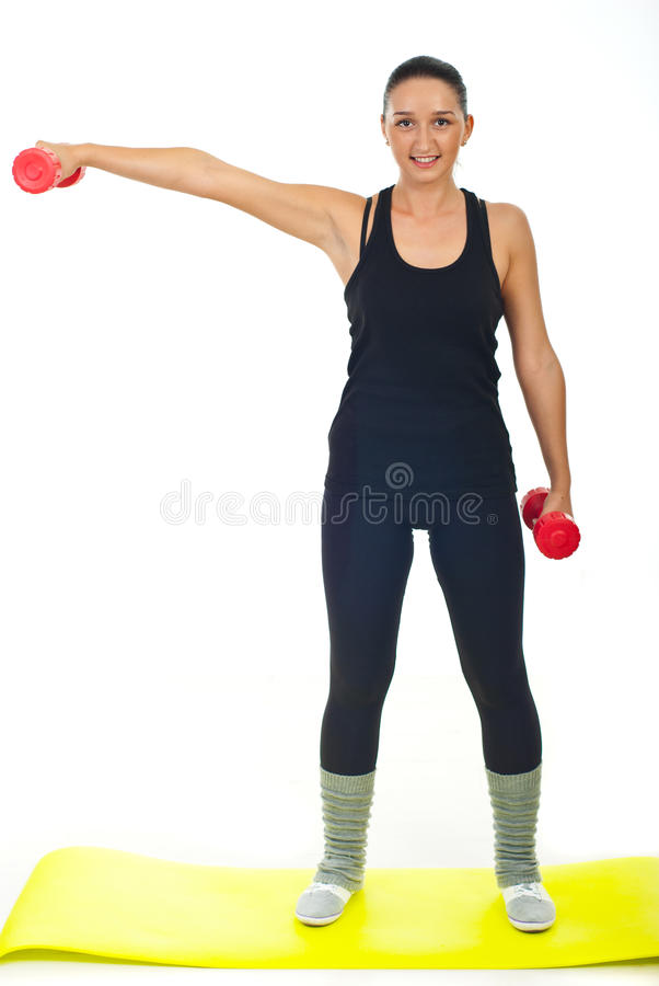 Fitness female with red barbell royalty free stock image