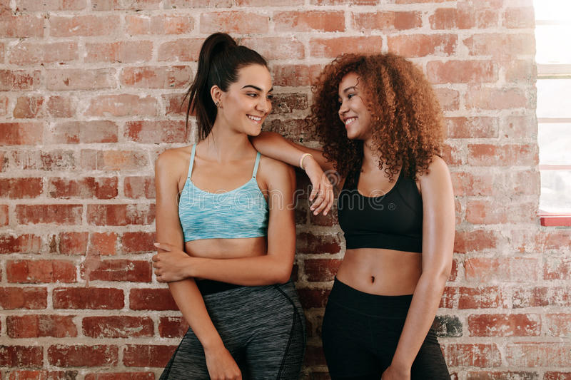 Fitness females in gym after workout royalty free stock photo