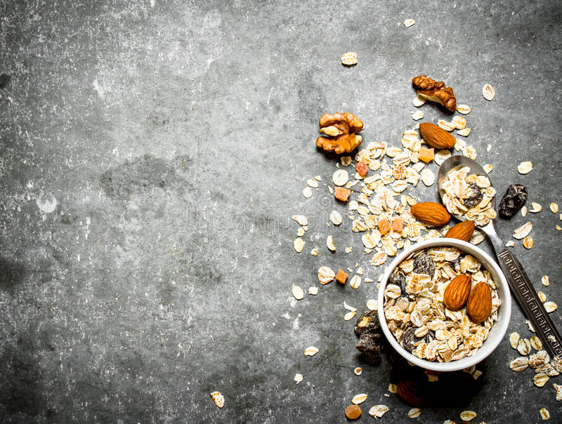 Fitness food. Cereals with dried fruit in the Cup. On the stone table royalty free stock photography
