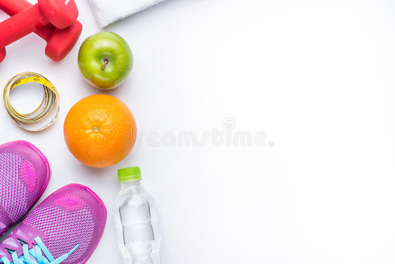 Fitness frame with dumbbells and green apple stock images
