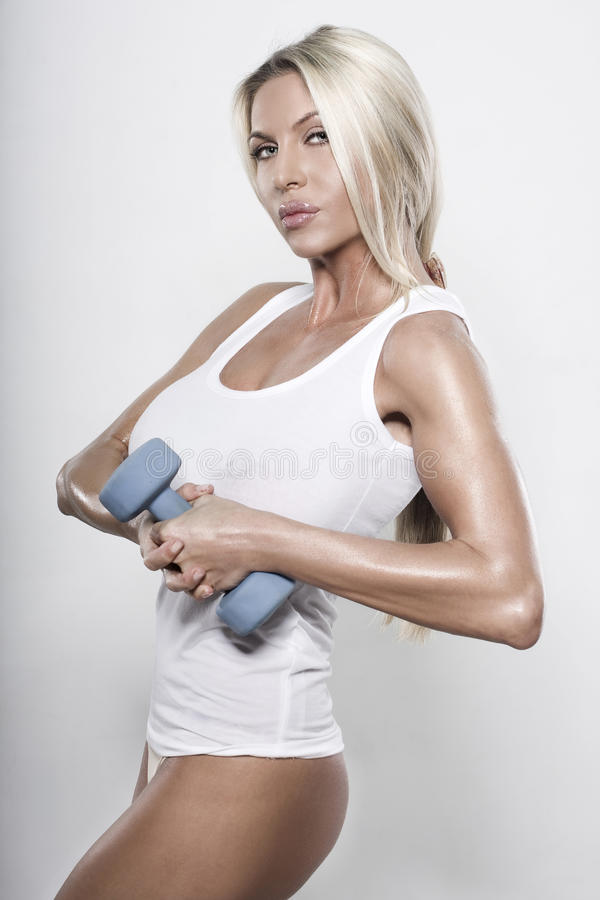 Fitness Girl. In studio on gray background stock images