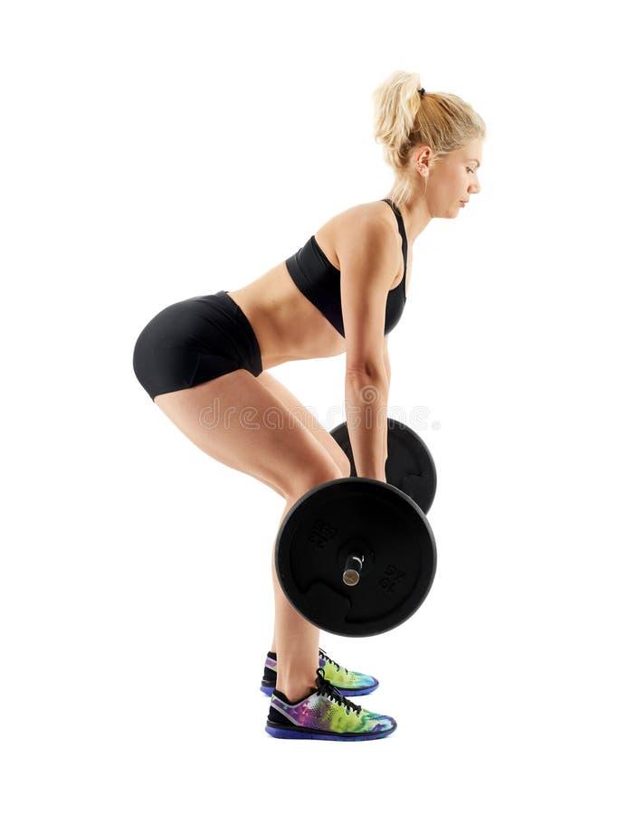 Fitness girl doing deadlift on white stock images