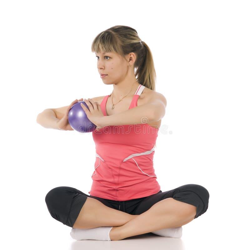 Fitness girl doing pilates stock images