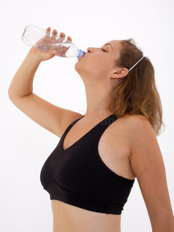 Fitness girl drinking water royalty free stock photos