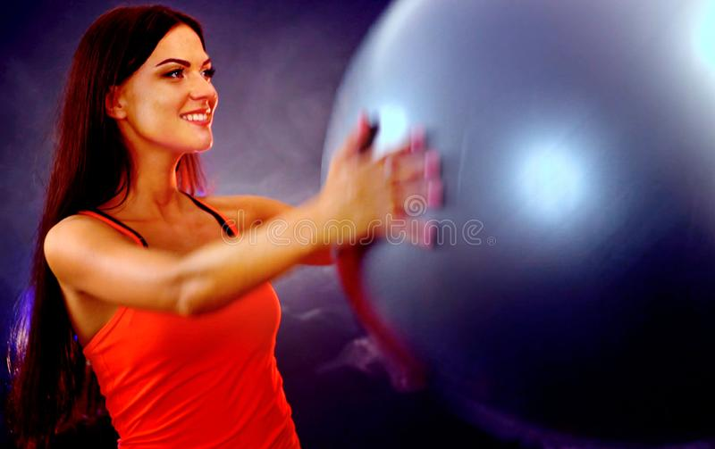 Fitness girl exercising in gym with fitball. stock photos