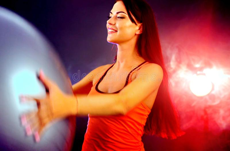 Fitness girl exercising in gym with fitball. stock images