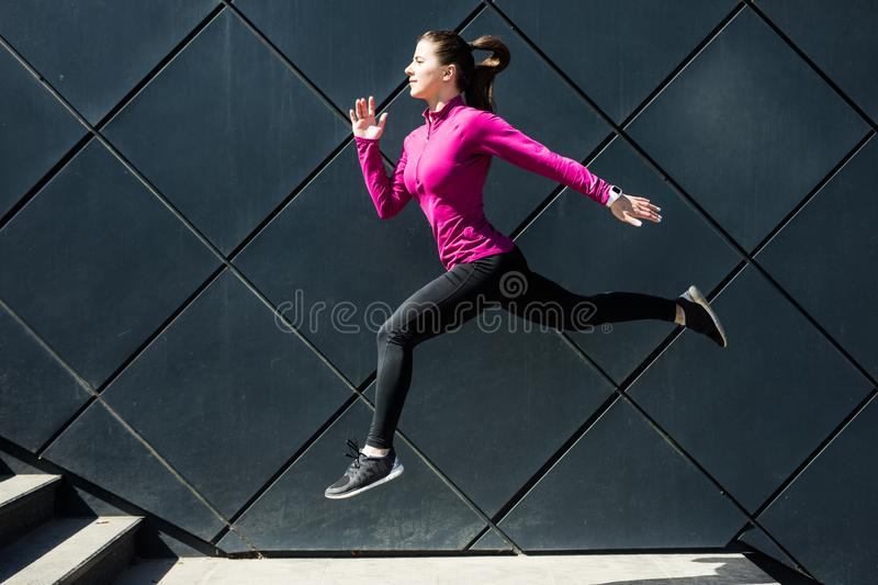 Fitness sport girl in fashion sportswear doing yoga fitness exercise in the street, outdoor sports, urban style. Fitness girl in fashion sportswear doing yoga royalty free stock image
