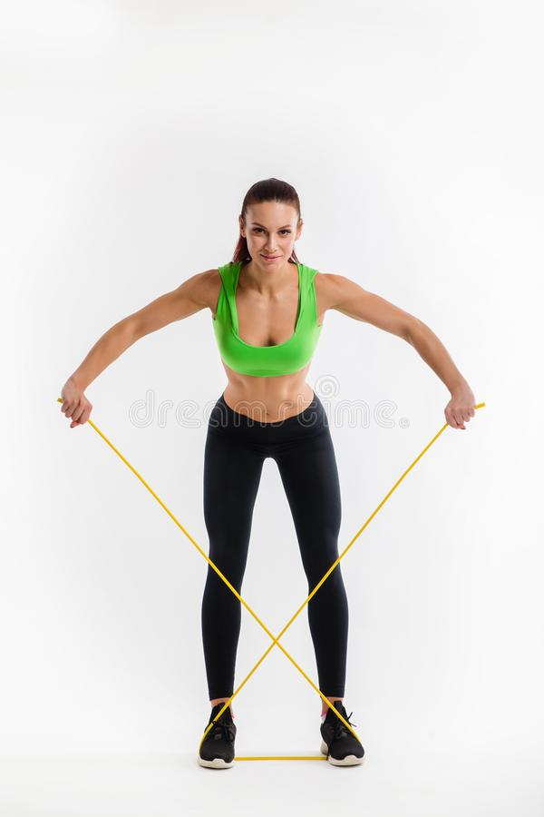 Fitness girl performs exercises with resistance band. Strength and motivation. Fitness girl performs exercises with resistance band. Photo of girl with beautiful stock images