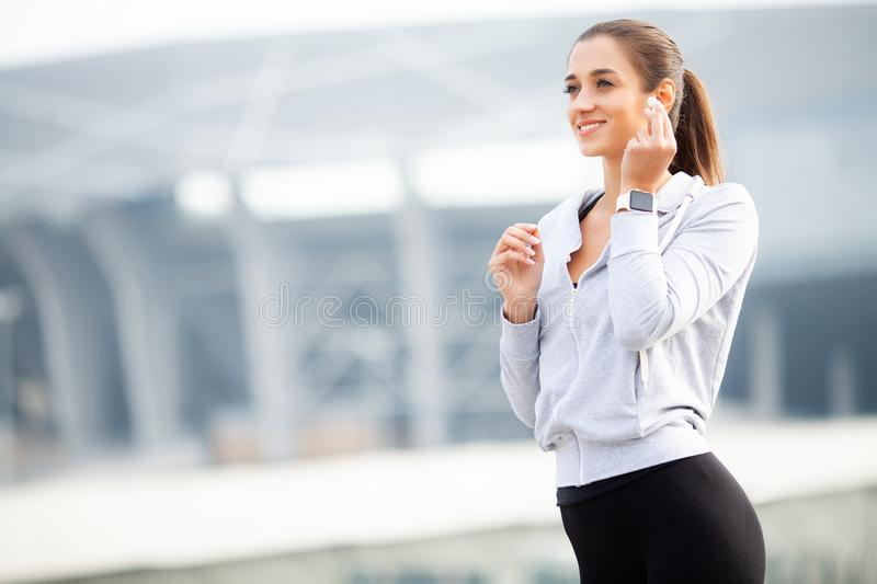 Fitness Girl. Portrait of a lovely young fitness girl listening music stock image