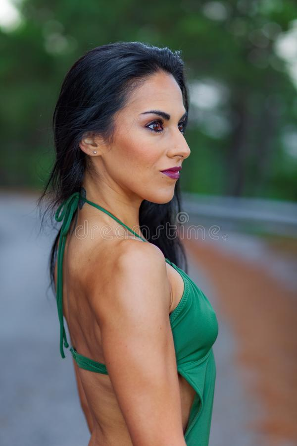 Fitness girl posing with a beautiful green .swimsuit stock photos