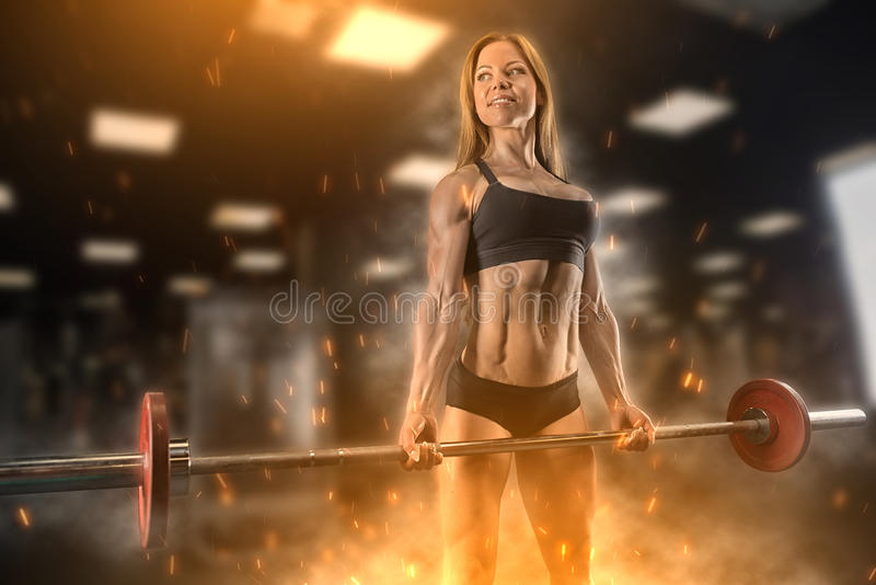 Fitness girl posing in the gym stock photography