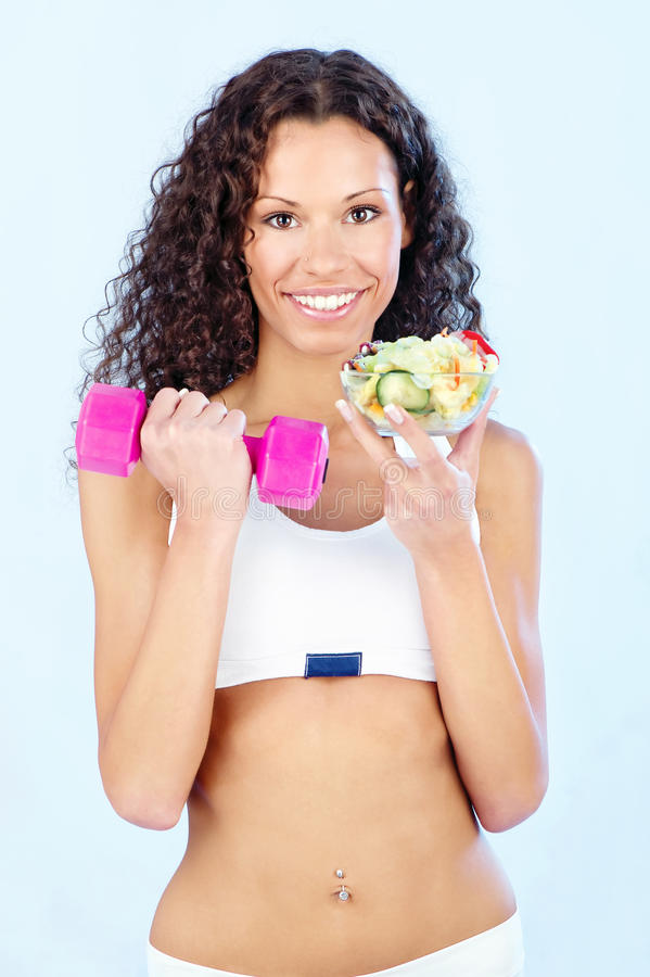 Fitness girl with salad and weight