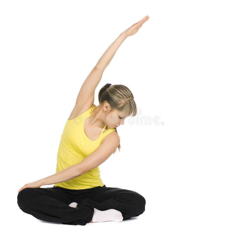 Fitness girl stretching stock photo