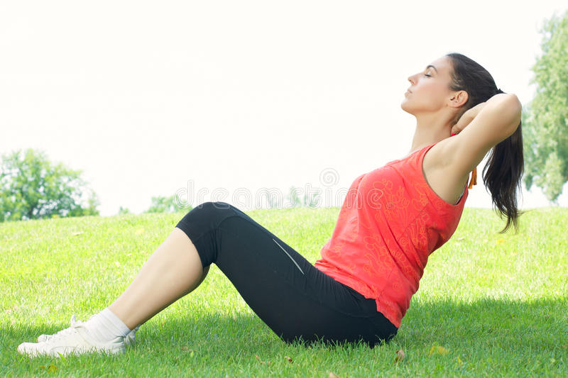 Fitness girl stretching outdoors royalty free stock photos