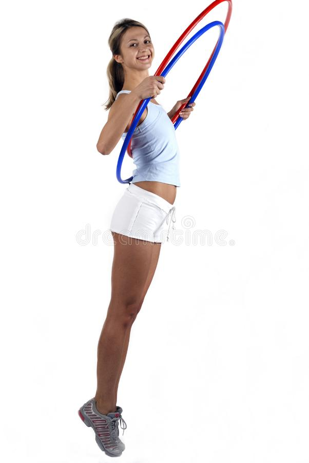 Fitness girl with two hoop stock images