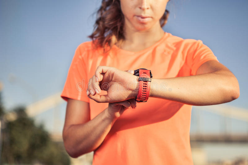 Fitness girl using activity tracker stock photos
