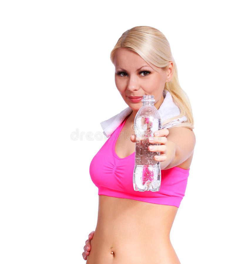 Fitness girl with water bottle and towel isolated on white background stock photos