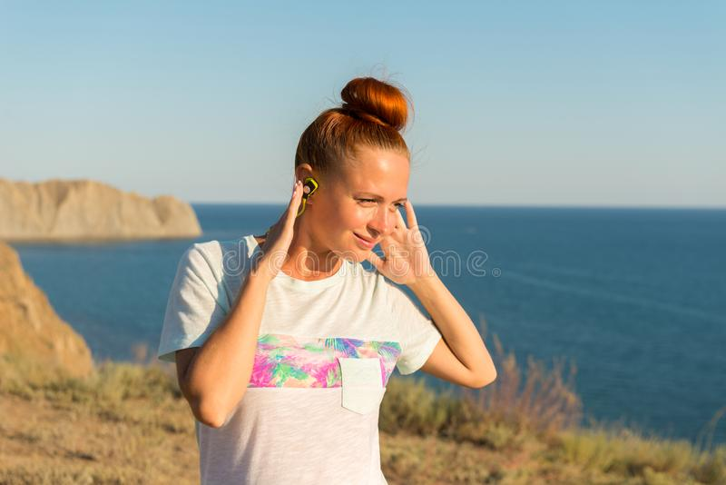Fitness girl with wireless headphones stock images