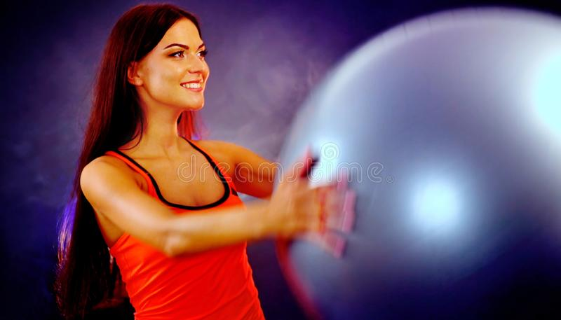 Fitness girl exercising in gym with fitball. stock photo