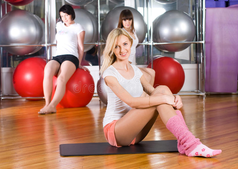 Fitness girls. Young woman in sport training at fitness center royalty free stock image