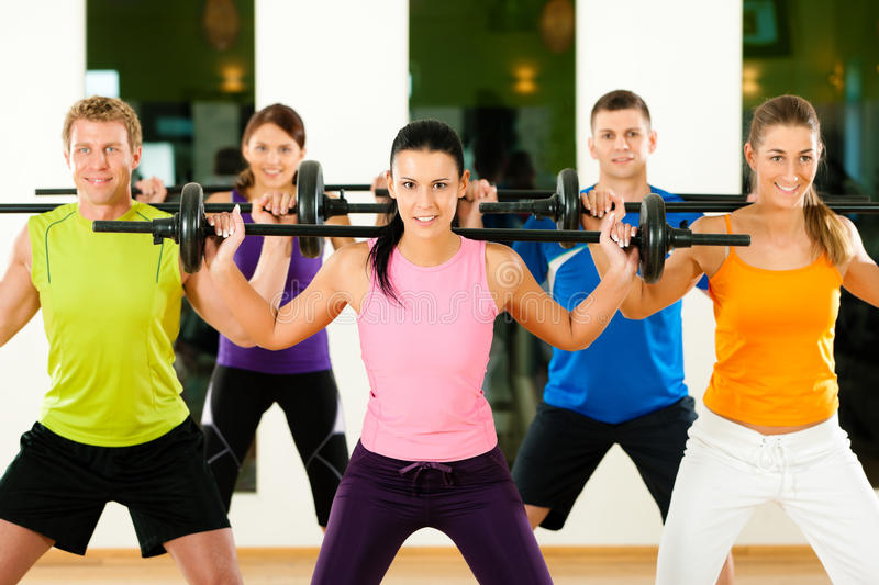 Fitness Group With Barbell In Gym Royalty Free Stock Images