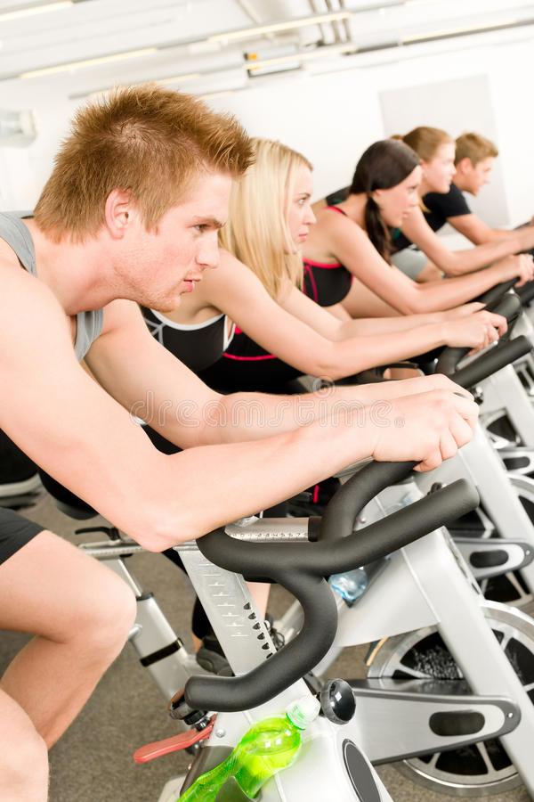Download Fitness Group Of People On Gym Bike Stock Image - Image: 19990377