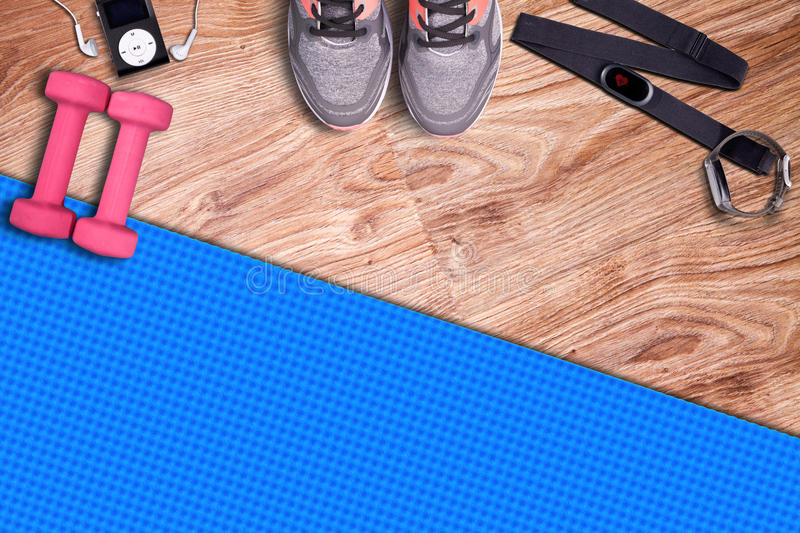 Fitness gym mat and light pink dumbbells. Fit equipment royalty free stock images