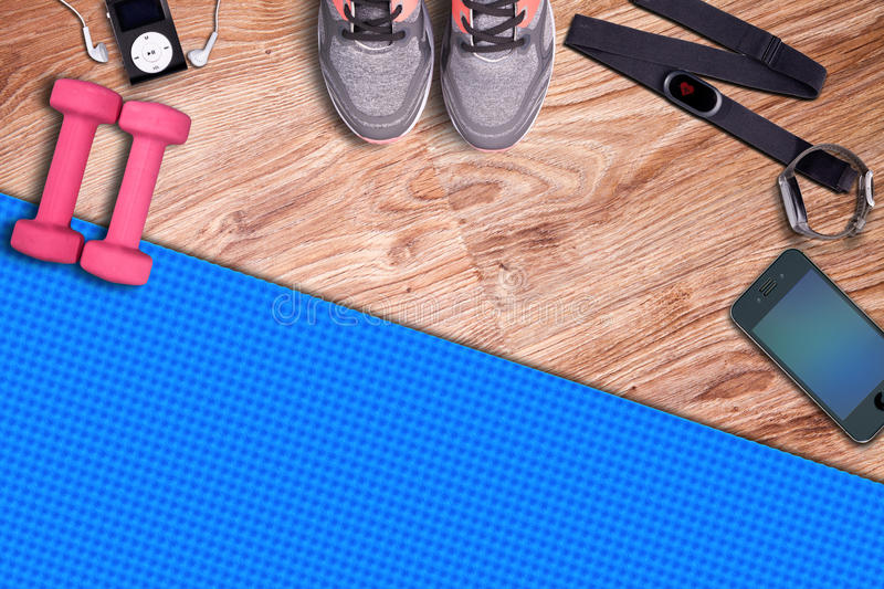 Fitness gym mat and light pink dumbbells. Fit equipment. stock image