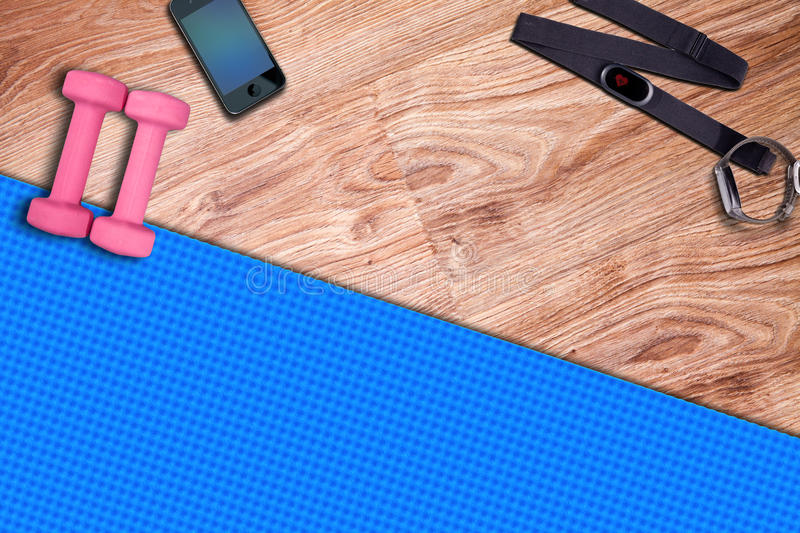 Fitness gym mat and light pink dumbbells. Fit equipment. stock images