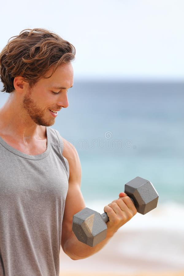 Fitness gym workout man lifting dumbbell weight doing bicep curl training arm exercise for biceps muscles stock photos
