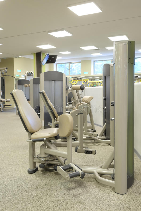 A fitness hall with sport equipment. Interior of a fitness hall with sport equipment royalty free stock images