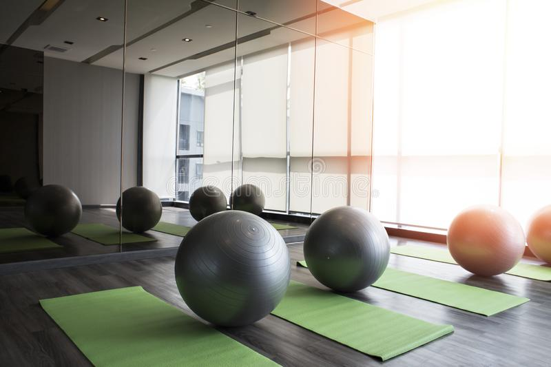 Fitness hall with sport equipment interior of gym with yoga royalty free stock photos